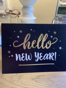 Olivia Newport new year card on desk